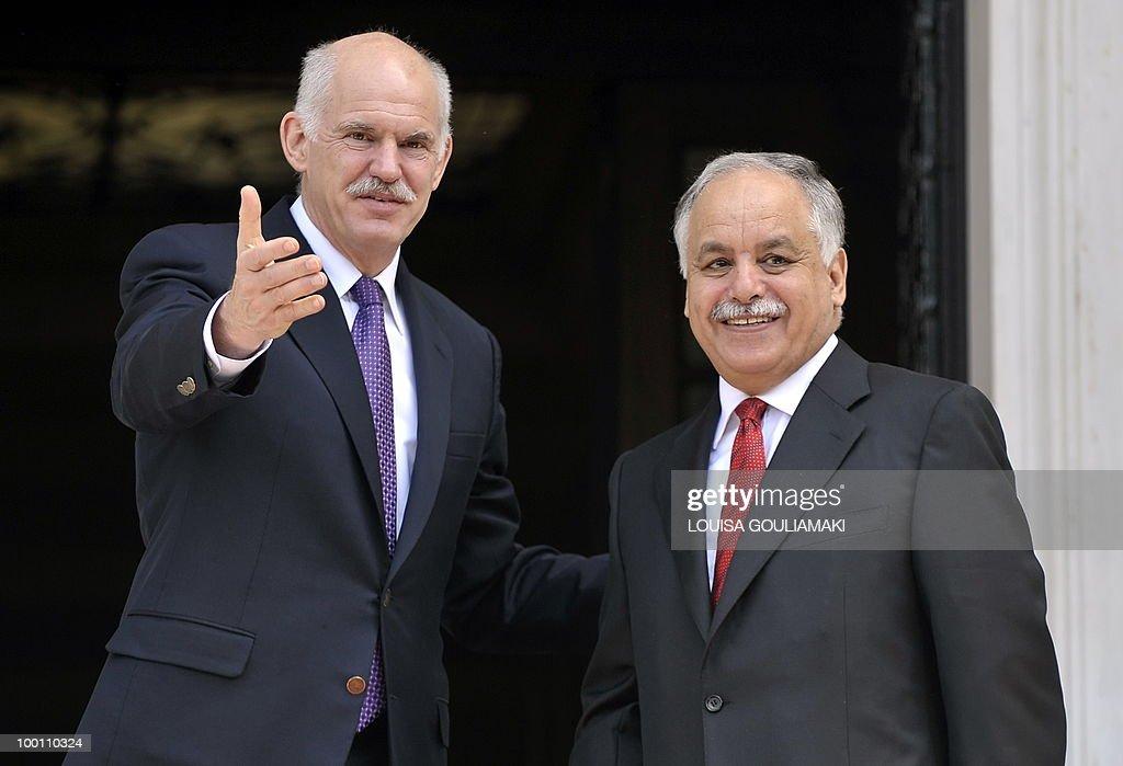 Greek prime minister George Papandreou (L) welcomes his Libyan counterpart, Al-Baghdadi Ali al-Mahmudi prior to their talks in Athens on May 21, 2010. AFP PHOTO / Louisa Gouliamaki