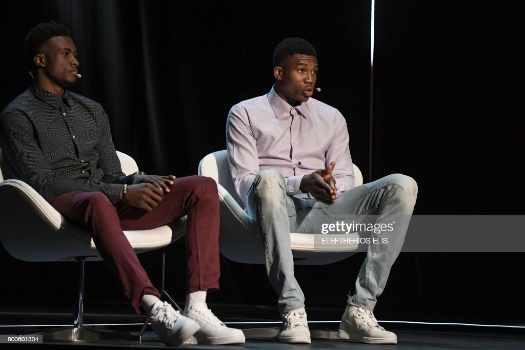 Greek professional basketball players, brothers Giannis (L) and Thanasis Antetokounmpo attend an interview at the Onassis Cultural Centre in Athens on June 24, 2017. / AFP PHOTO / Eleftherios Elis