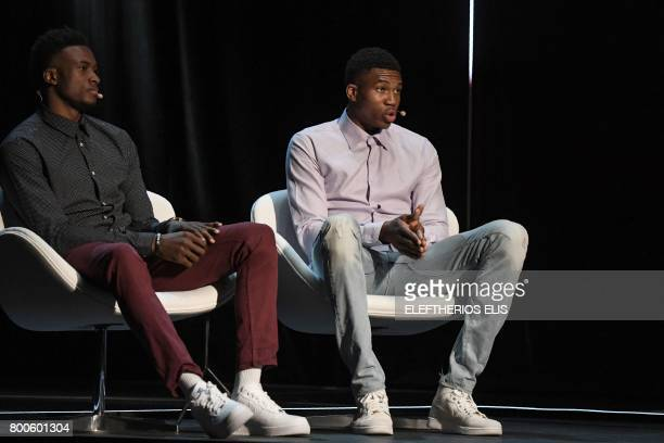 Greek professional basketball players brothers Giannis and Thanasis Antetokounmpo attend an interview at the Onassis Cultural Centre in Athens on...