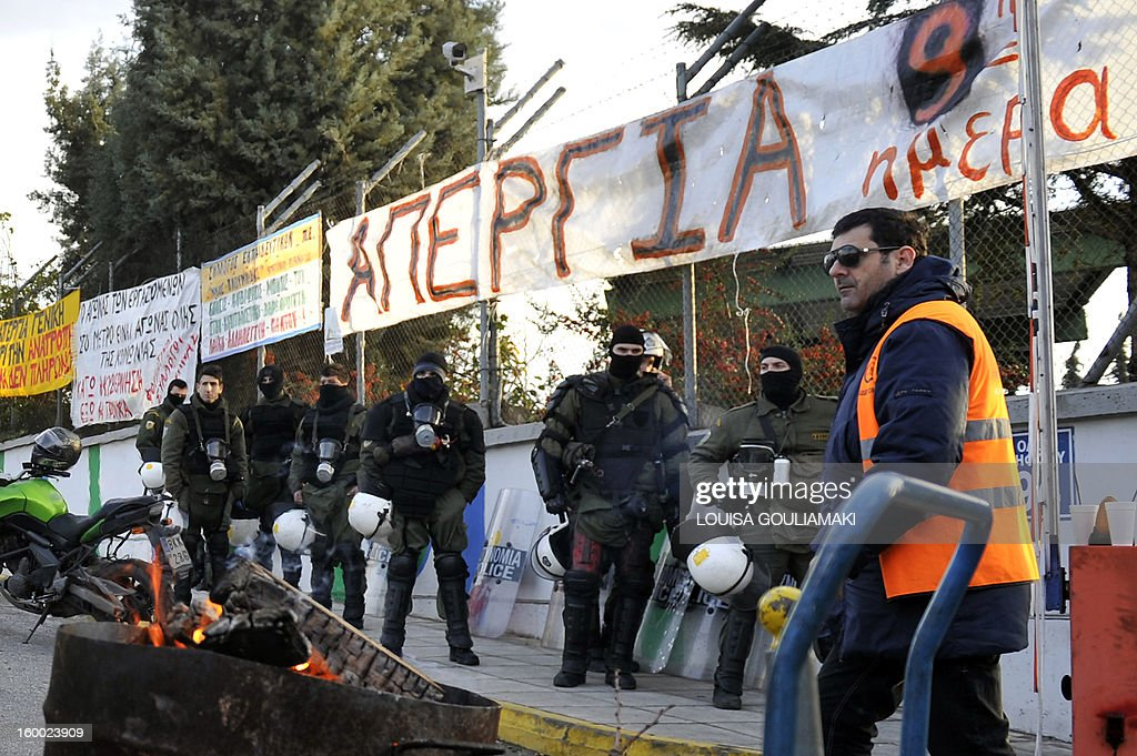 Greek riot police block the access to the main Athens metro depot on January 25, 2013 to break up a sit-in by striking workers. The raid on the centre, which strikers protesting austerity measures had occupied took place overnight. The government had ordered a civil mobilisation the day before to force the Athens metro staff to halt their strike, which has disrupted traffic in the Greek capital for over a week. Unions reacted by calling a general transport standstill today.