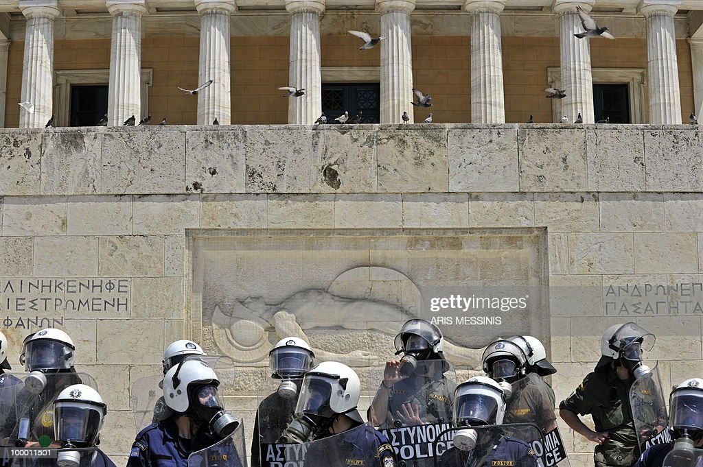 Greek riot police guard the tomb of the unknown soldier outside the parliament during a protest marking the 24-hour general strike against the austerity measures in central Athens on May 20, 2010. Thousands of protesters took to the streets of Athens and second city Thessaloniki in a new general strike against the government's debt-dictated austerity spending cuts and pension reform during a 24-hour general strike on May 20, 2010.