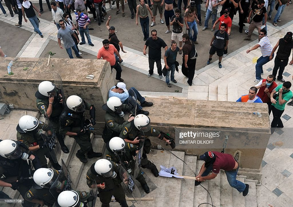 Greek riot policemen clash with protestors in the center of Athens on May 5, 2010. A nationwide general strike gripped Greece in the first major test of the socialist government's resolve to push through unprecedented austerity cuts needed to avert fiscal meltdown.