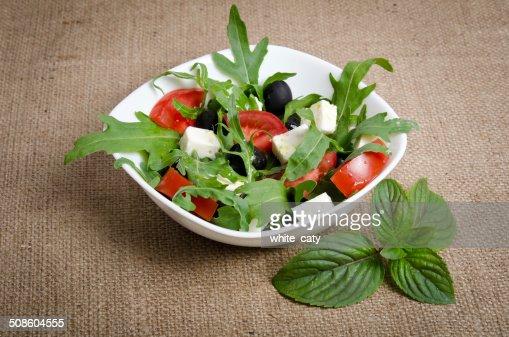 Greek salad in white salad bowl : Stock Photo