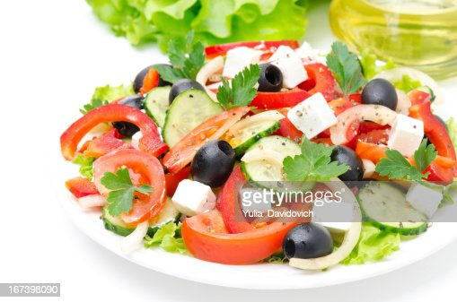 Greek salad with feta cheese, olives and vegetables : Stockfoto