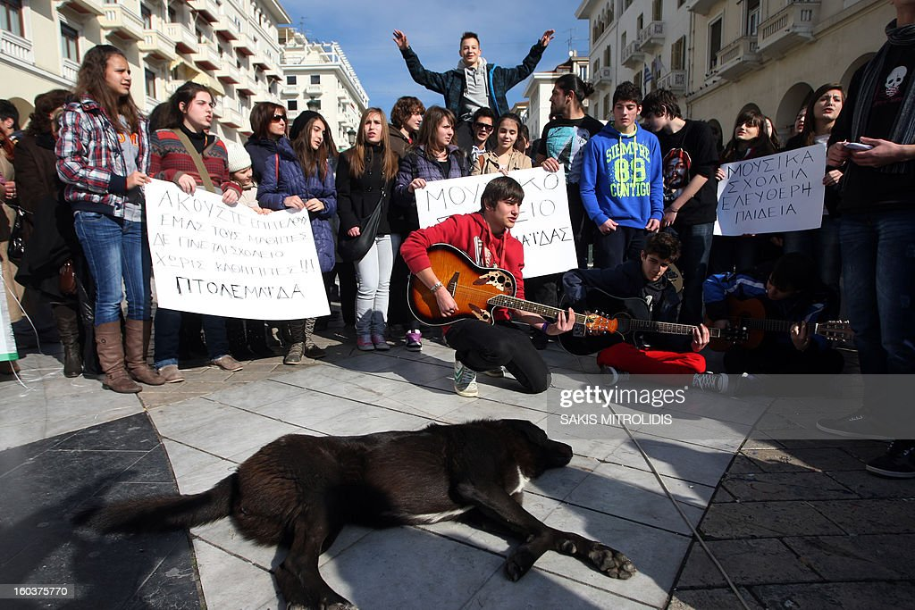 Greek schoolchildren protest in Thessaloniki against education budget cuts on January 30, 2013. With drums and guitars, students of public music high schools launched a protest against the cancellation of their transportation to schools and education budget cuts.AFP PHOTO /Sakis Mitrolidis