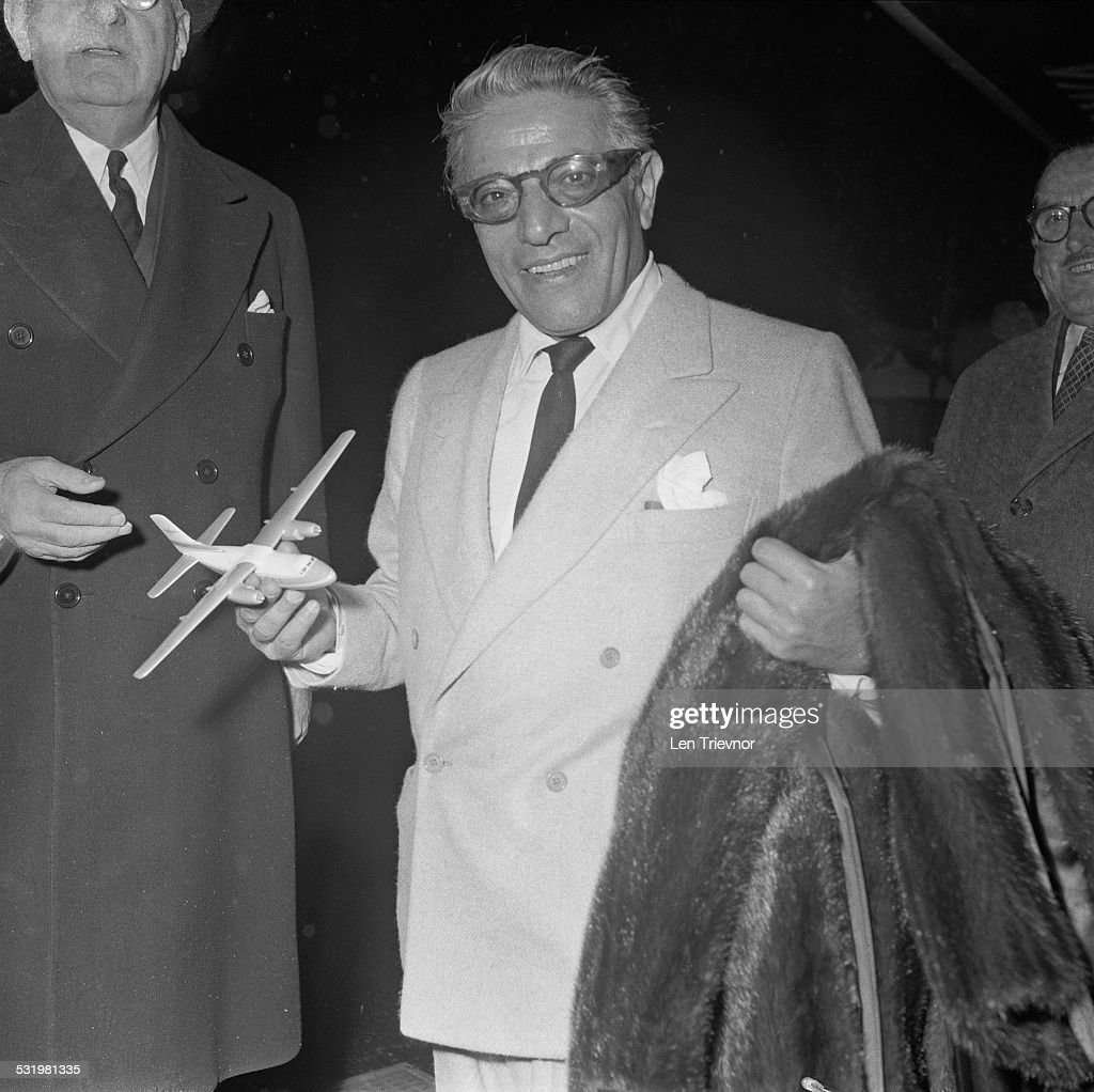 Greek shipping magnate <a gi-track='captionPersonalityLinkClicked' href=/galleries/search?phrase=Aristotle+Onassis&family=editorial&specificpeople=217821 ng-click='$event.stopPropagation()'>Aristotle Onassis</a> (1906 - 1975) carrying his mink fur coat, Monaco, 3rd November 1959.