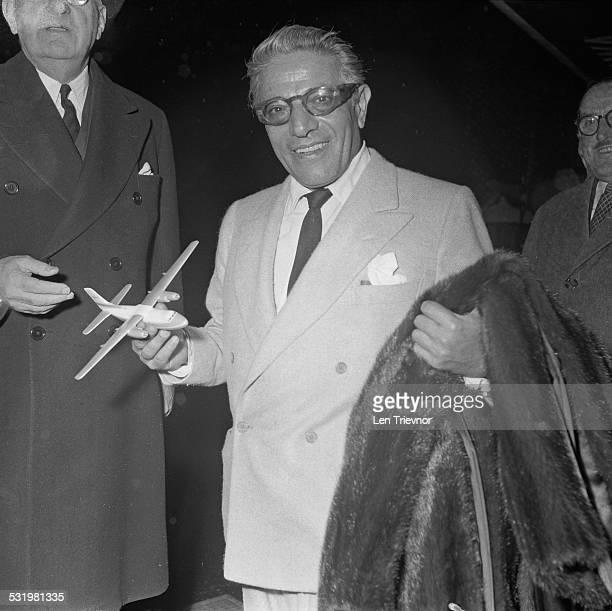 Greek shipping magnate Aristotle Onassis carrying his mink fur coat Monaco 3rd November 1959