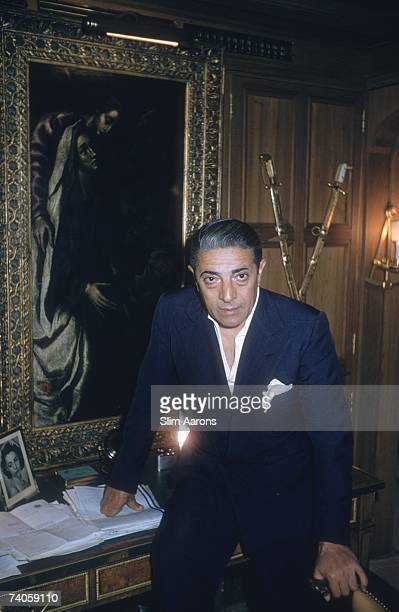 Greek shipping magnate Aristotle Onassis in the office aboard his yacht 'Christina' August 1956 He is standing next to an El Greco painting and...