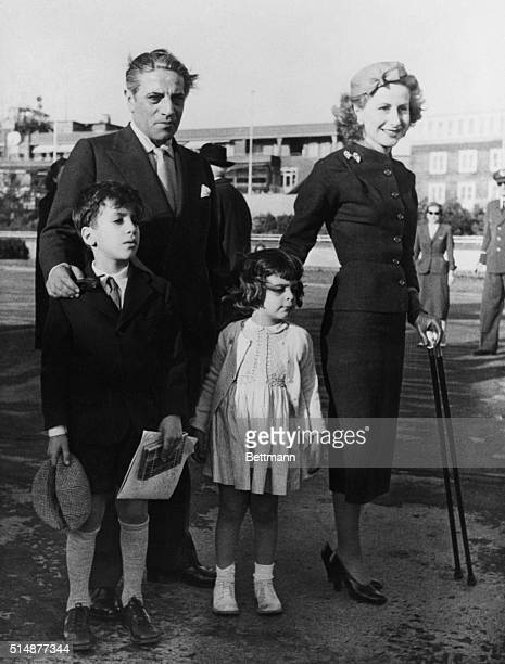 Greek shipping magnate Aristotle Onassis is shown with his wife Tina and their children Alexander and Christina at the launching of one of his new...