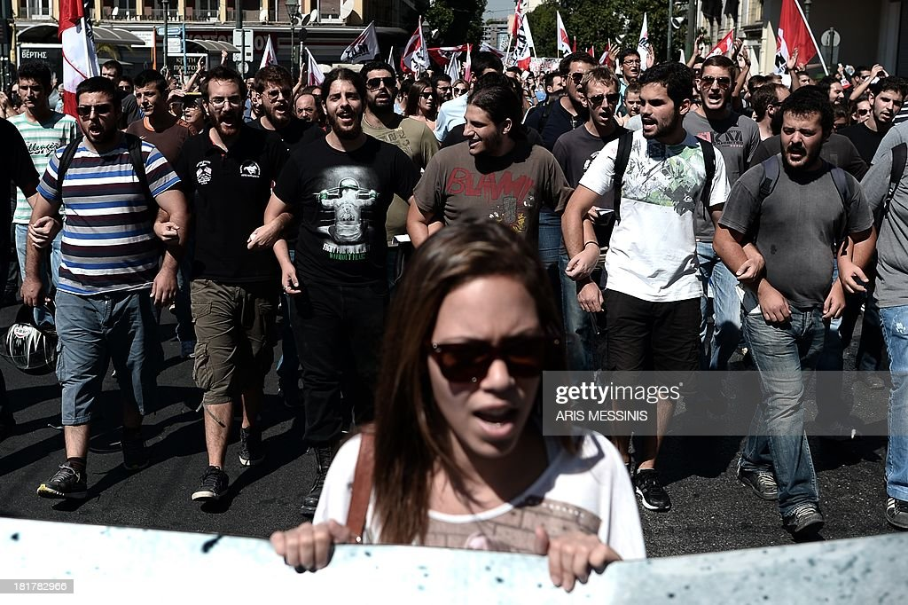 Greek students shout slogans during an anti-fascist protests in Athens on September 25, 2013. Most of the country's mainstream parties called for a large turn-out in the early evening protests, which were sparked by the murder of an anti-fascist musician, allegedly at the hands of a self-confessed neo-Nazi last week.