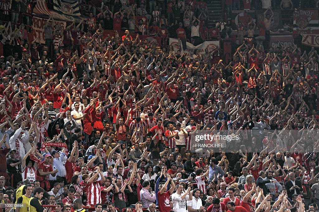 Greek supporters of Olympiakos celebrate the victory of their team after the Final Four semifinal of Euroleague basketball match between Partizan Belgrade and Olympiakos, on May 7, 2010 at the Bercy Palais Omnisport, in Paris. Olympiakos won 83-80.