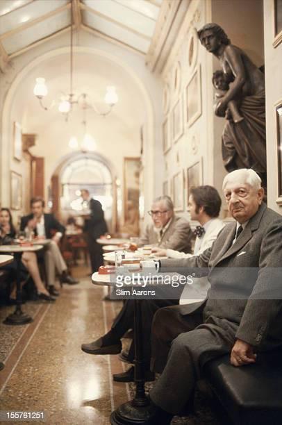 Greek surrealist painter Giorgio de Chirico and Raoul Genco in the Cafe Greco Rome Italy in June 1973