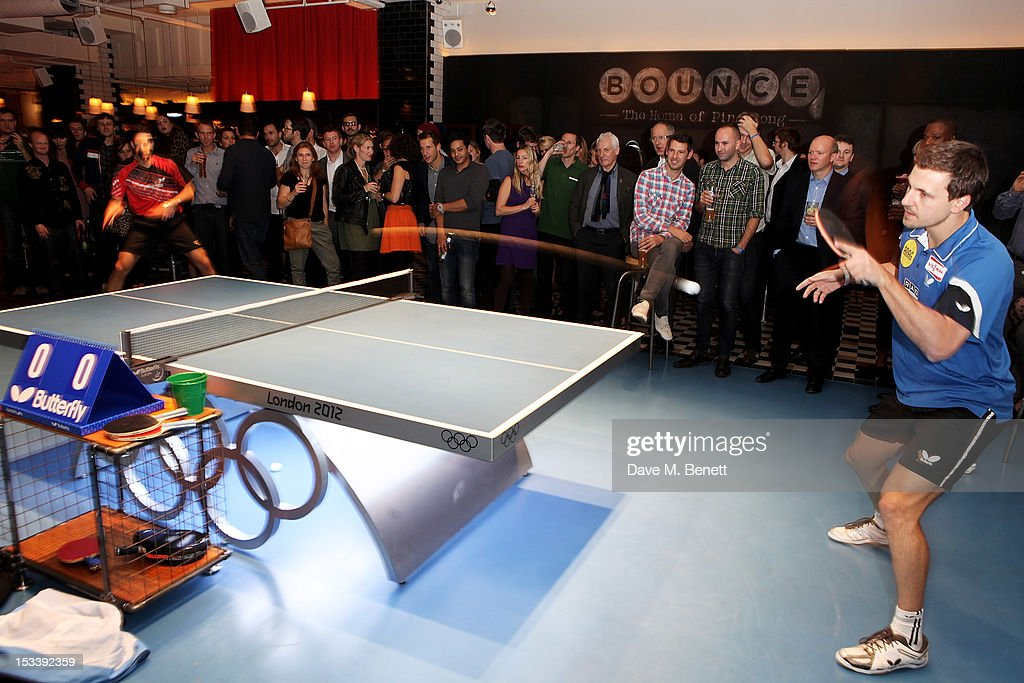 Greek table tennis player Panagiotis Gionis (L) and German professional table tennis player Timo Boll play at the launch of Bounce, Holborn's new Ping Pong club, on October 4, 2012 in London, England.