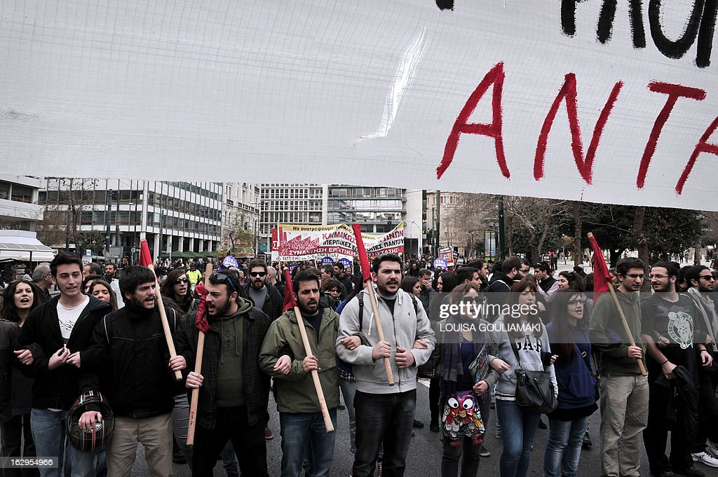 Greek teachers and students take part in a protest march in central Athens on March 2, 2013 against cutbacks in the public education system due to the government's austerity measures. Demonstrators protested on March 2 lack of heat and food in many schools and the overall downgrade of the public education.