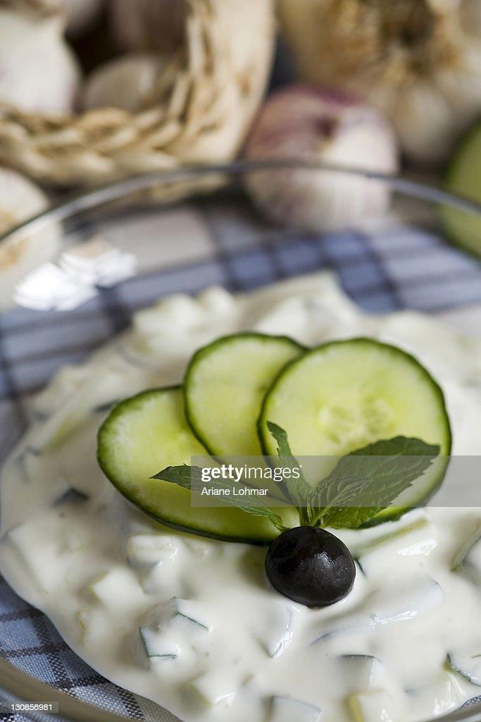 Greek Tzatziki, yoghurt, quark, cucumber, olive, mint, garlic, fresh, dried, table cloth, blue, white