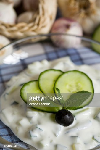 Greek Tzatziki, yoghurt, quark, cucumber, olive, mint, garlic, fresh, dried, table cloth, blue, white