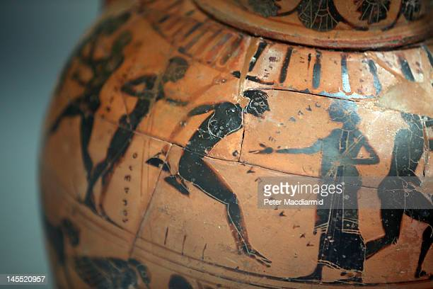Greek vase from 540 BC depicting a competitor taking part in the long jump of the ancient Olympics is displayed in The British Museum's 'Winning at...