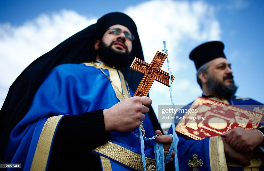 Greek vicars are seen as Greek Orthodox celebrate Epiphany on January 6, 2013 in Thessaloniki, Greece. The feast day traditionally commemorates when Jesus was baptised in the River Jordan.