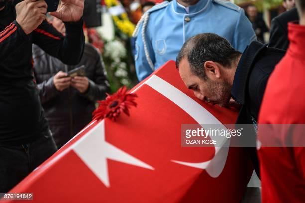 Greek weightlifter Valerios Leonidis kisses the coffin of Turkey's legendary triple Olympic goldmedal weightlifter Naim Suleymanoglu on November 19...