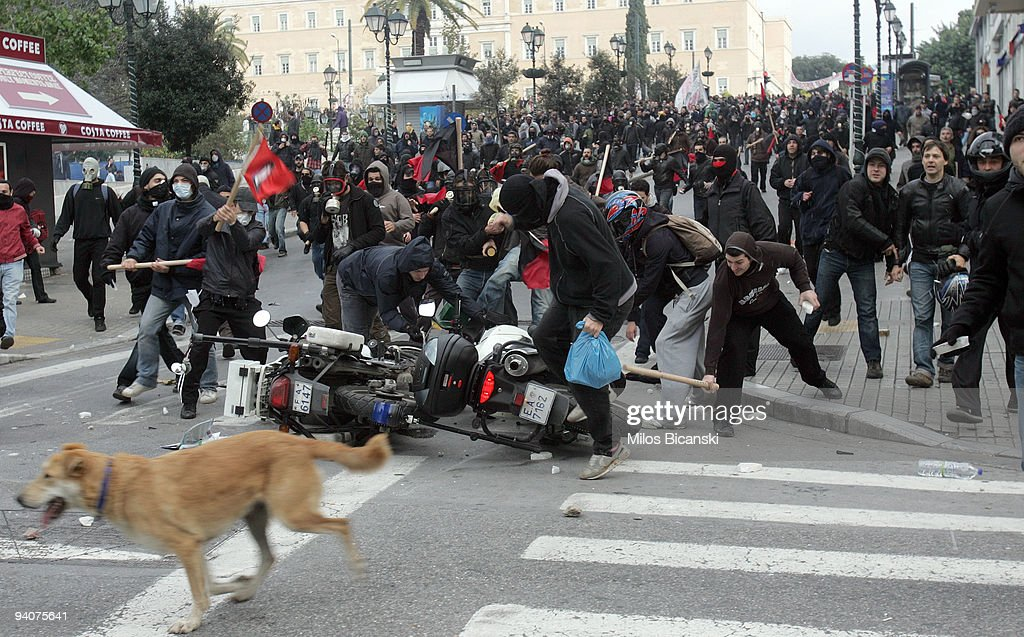 Greek youths clash with riot police during a demonstration commemorating the fatal shooting of 15-year-old Alexandros Grigoropoulos by police a year ago, on December 6, 2009 in central Athens, Greece. Two police officers will go on trial in the new year for the murder of Grigoropoulos.
