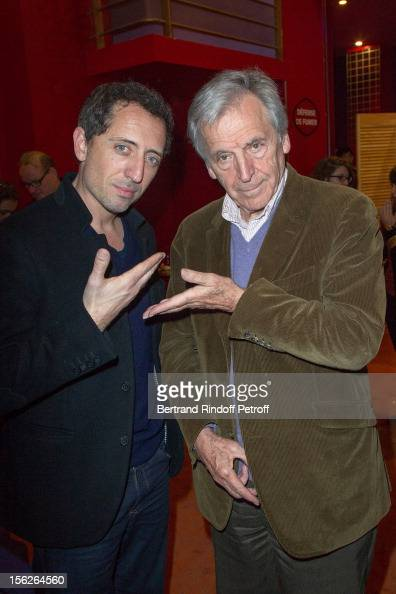 Greekborn filmmaker CostaGavras and actor Gad Elmaleh pose as they attend 'Le Capital' premiere at Gaumont Parnasse on November 12 2012 in Paris...