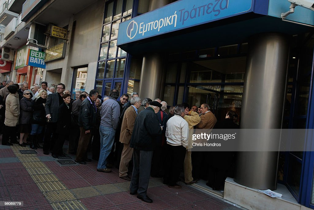 Greeks line up outside a bank for their pension checks March 26, 2010 in Athens, Greece. Leaders of the sixteen euro zone countries along with the International Monetary Fund agreed March 26 to provide Greece with 22 billion euro loan to help the country with its staggering debts, though it will only be available if open market lending to Greece dries up.