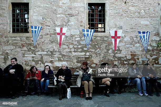 Greeks Orthodox believers at the church of the Holy Sepulchre waiting for the holy Light to arrive in Athens on Holy Saturday
