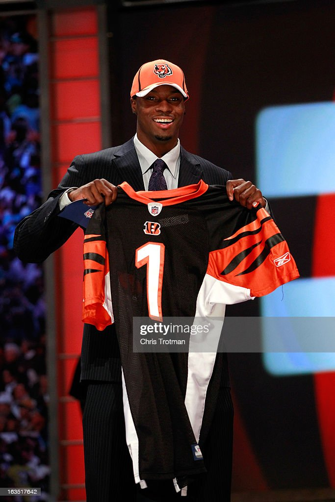 <a gi-track='captionPersonalityLinkClicked' href=/galleries/search?phrase=A.J.+Green&family=editorial&specificpeople=5525868 ng-click='$event.stopPropagation()'>A.J. Green</a>, #4 overall pick by the Cincinnati Bengals, holds up a jersey after he was drafted during the 2011 NFL Draft at Radio City Music Hall on April 28, 2011 in New York City.