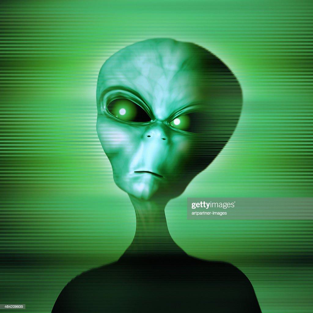 Green alien looking angry or dangerous