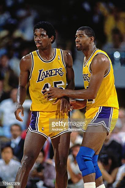 C Green and Magic Johnson of the Los Angeles Lakers talk during Game Four of the 1988 NBA Finals on June 14 1988 at the Great Western Forum in...