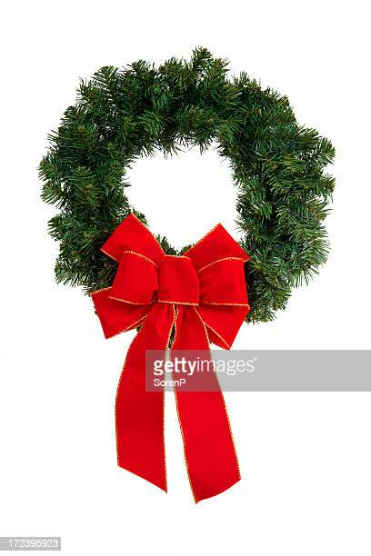A green and red Christmas wreath against a white background