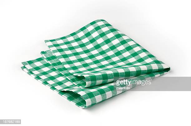 Green and white checked napkin roughly folded