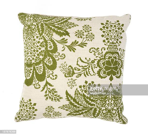 Green and white couch pillow with a floral pattern