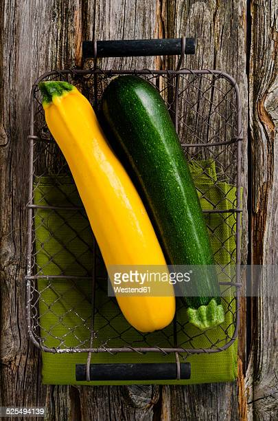 Green and yellow courgettes in a basket