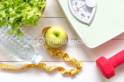 Green apple and Weight scale,measure tap with fresh vegetable, clean water and sport equipment for women diet slimming.  Diet and Healthy Concept : Stock Photo