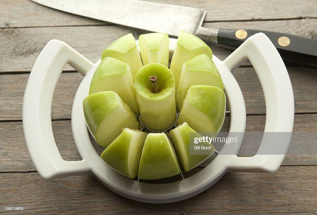 Green apple in an apple slicer