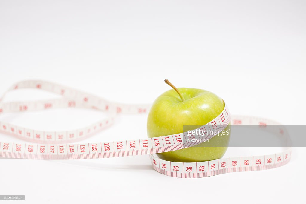 Green apple with measurement isolated on white : Stock Photo