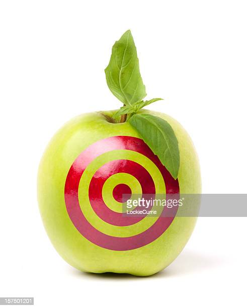 Green apple with target drawn on it
