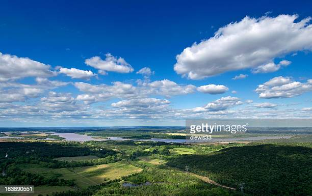 Green Arkansas landscape under a blue cloudy sky