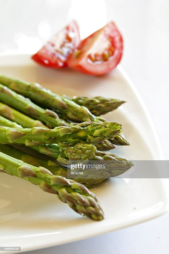 green asparagus on white plate : Stock Photo