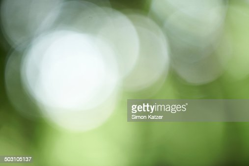 Green background with bright blurred dots