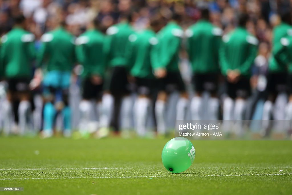 A green balloon on the pitch as the Plymouth Argyle team line up before the Sky Bet League Two Play Off Final between Plymouth Argyle and AFC Wimbledon at Wembley Stadium on May 30, 2016 in London, England.