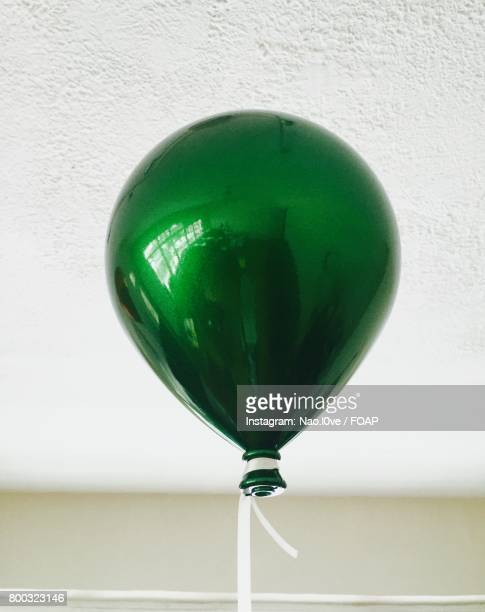 Green balloon tied to a string