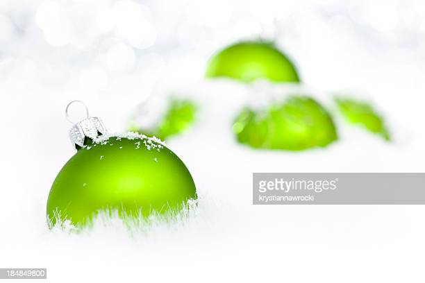 Green Baubles on snow