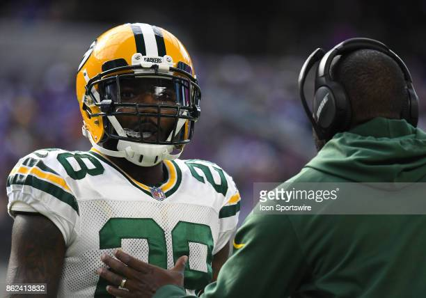 Green Bay Packers cornerback Josh Hawkins talks to a coach during a NFL game between the Minnesota Vikings and Green Bay Packers on October 1 2017 at...