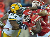 Green Bay Packers defensive end Josh Boyd catches Kansas City Chiefs running back Cyrus Gray on a secondquarter run during a preseason game at...