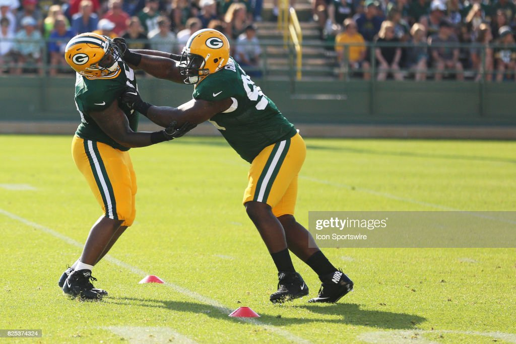 Green Bay Packers defensive tackle Letroy Guion (98) blocks Green Bay Packers defensive tackle Ricky Jean Francois (95) during Packers training camp at Ray Nitschke Field on August 1, 2017 in Green Bay, WI.