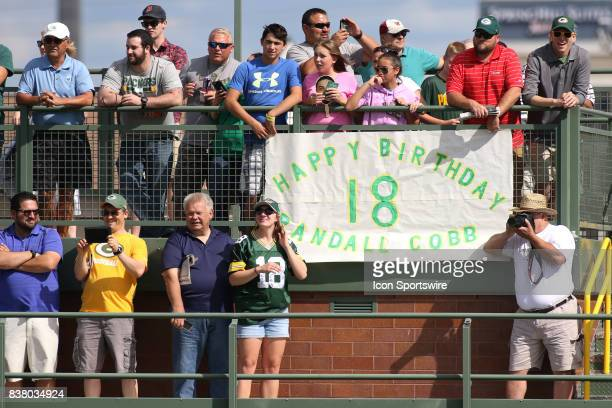 Green Bay Packers fans held up a birthday greeting for Green Bay Packers wide receiver Randall Cobb during Packers training camp at Ray Nitschke...