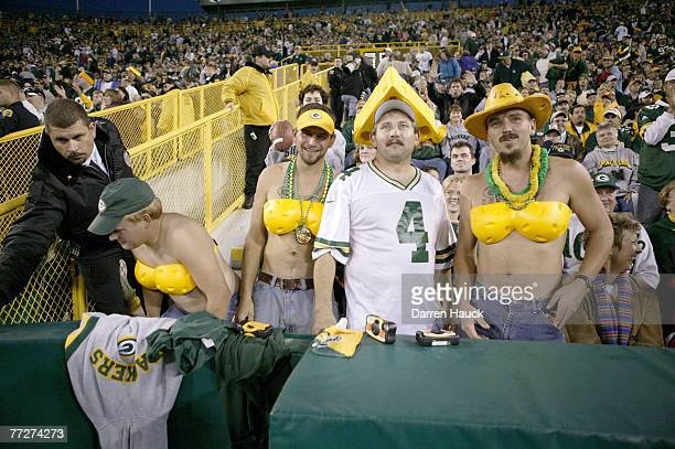 Green Bay Packers fans watch the end of the game against the Dallas Cowboys Sunday Oct 24 2004 game at Lambeau Filed in Green Bay Wis