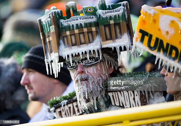 Green Bay Packers fans with a frozen tundra hat on during the Tennessee Titans game at Lambeau Field on December 23 2012 in Green Bay Wisconsin
